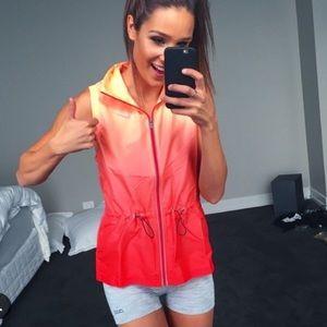 Orange Nike women's running vest